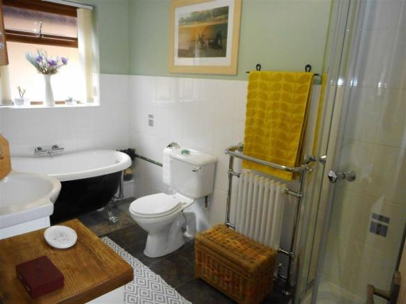 PARTLY TILED FAMILY BATHROOM/WC