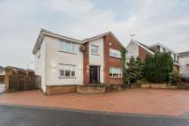 Detached home in 21 Whirlie Road...