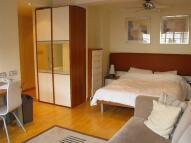 Studio flat in Roland Gardens...