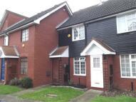 Terraced property in King Henrys Mews, Enfield
