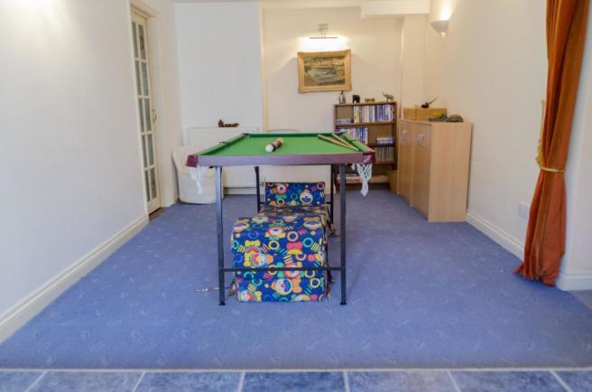 Lounge/Games Area (Garden Level Guest Suite)