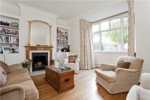 semi detached property in Clavering Avenue, London...