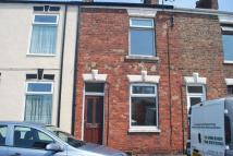 Terraced property in King Street, WITHERNSEA...