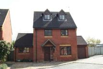 Detached home in Woodmans Close...