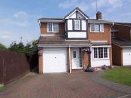 Detached home in Orchid Close...