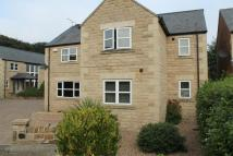Detached house in Lundhill Farm Mews...