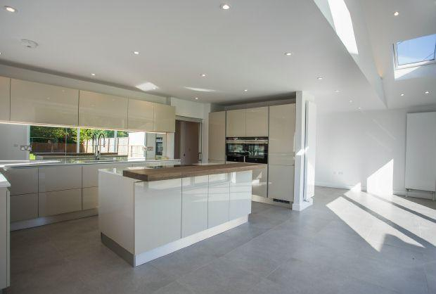 Kitchen area with high glass doors