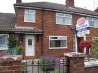 Terraced home in Dee Road, Garden City...