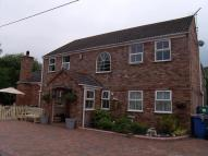 Detached home in Llay Road, Llay, Wrexham...