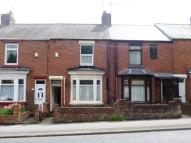 Terraced property in Grove Terrace...