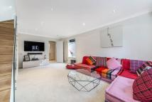 Detached home in Chatto Road, London
