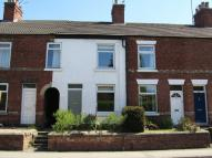 Terraced property in Derby Road...