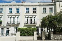 Terraced property in Kensington Park Road...