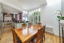 Terraced property in Kensington Park Road...