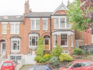 semi detached home in WOODLAND GARDENS, London...