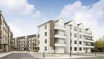 Terraced property in Kew Bridge Court...