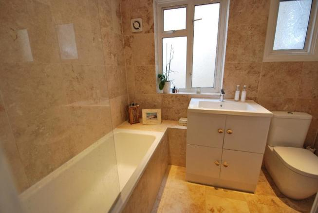 Luxurious Fully-Tiled Bathroom