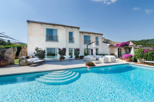Swimming pool sun terrace rear facade Villa Cassedda Porto Cervo Sardinia