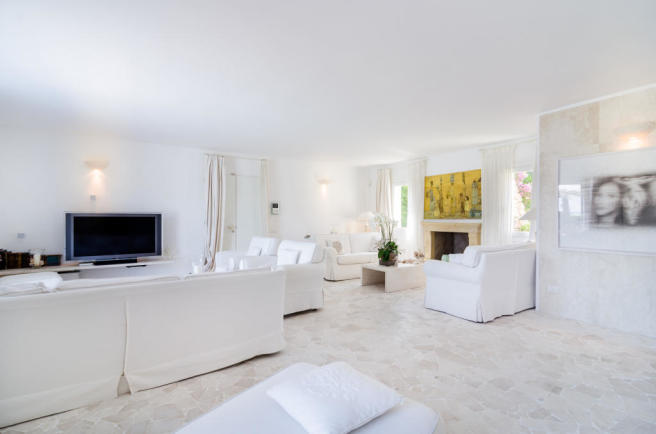 Living room fireplace stone floor Villa Cassedda Porto Cervo Sardinia