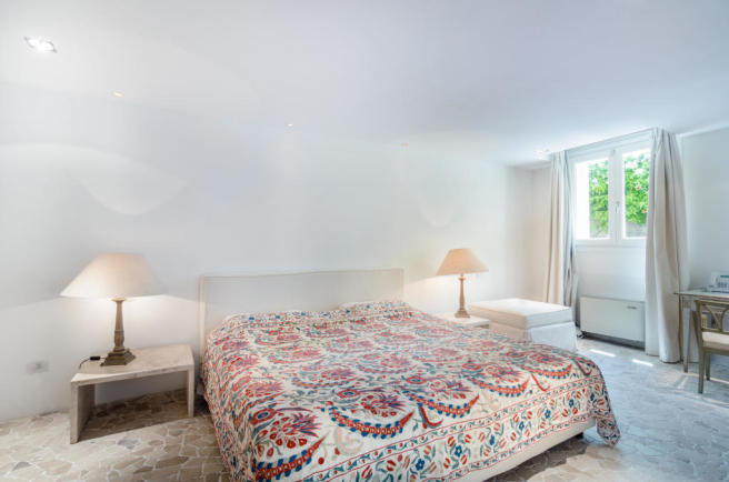 Bedroom stone floor Villa Cassedda Porto Cervo Sardinia