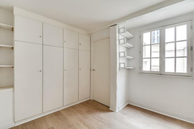 Bedroom built-in storage wood floor Quincampoix Paris