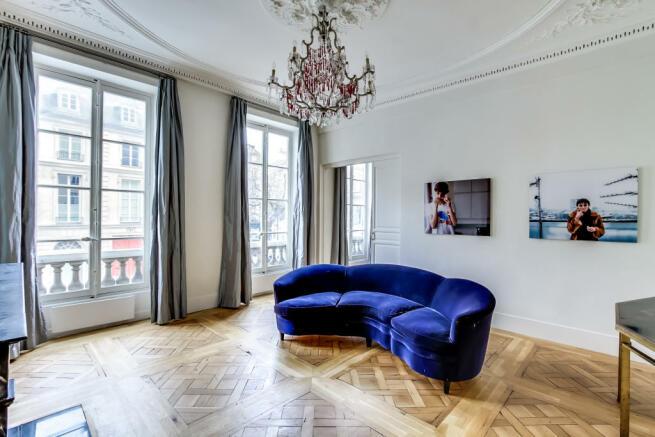 Living room parquet flooring wood chandelier Saint Germain des pres Luxembourg Gates Paris