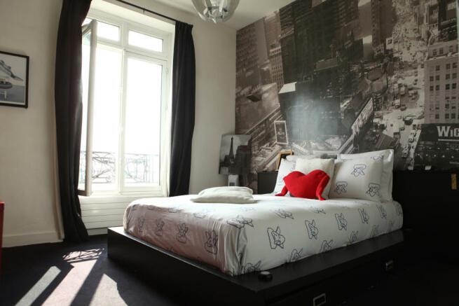 Master bedroom wood floor large window Etoile Avenue President Wilson Paris