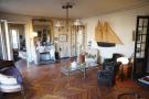Living room parquet wood floor chandelier Marais Beaumarchais Paris