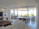 Living room dining open plan sliding doors balcony stone floor Billionaire Resort Kenya