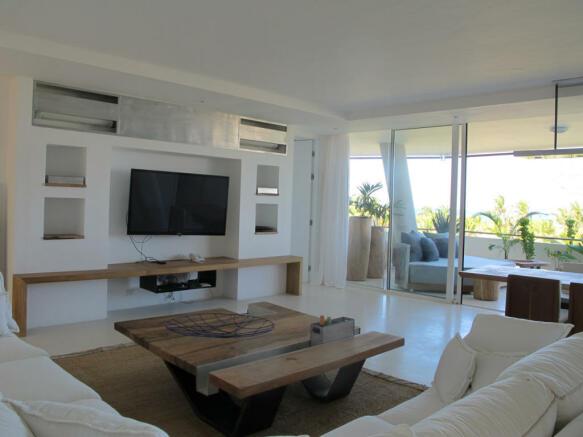 Living room open plan sliding doors balcony stone floor Billionaire Resort Kenya