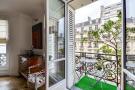 Balcony doors iron railings Rue Jean Mermoz Paris
