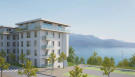 Corner view CGI of Les Terrasses du Lac with views of Lac Lemán