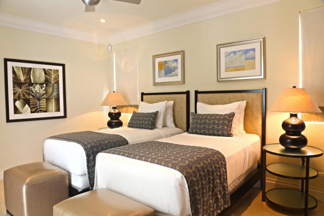 Twin bedroom in apartment at The Landings in St Lucia