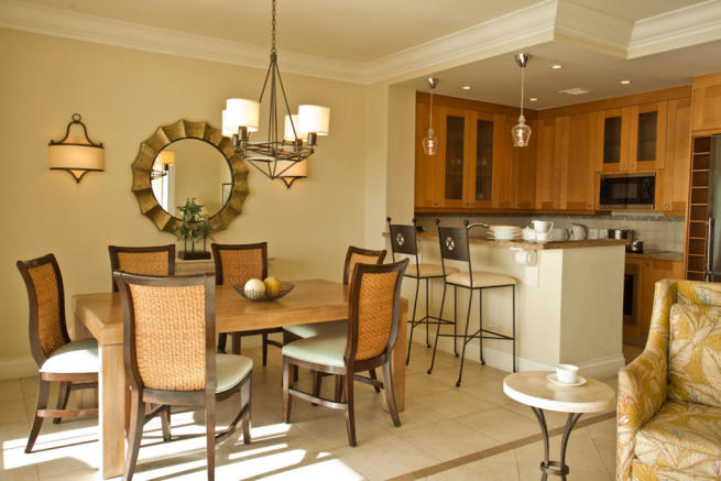 Dining room and kitchen in a Marina Residence apartment at The Landings in St Lucia