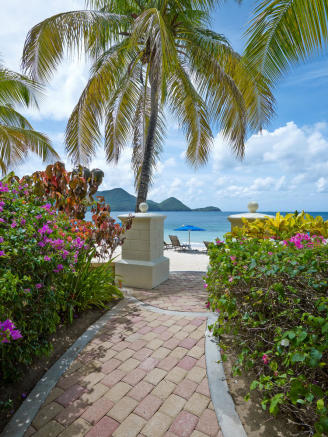 Path from ground floor apartment to the beach at The Landings in St Lucia