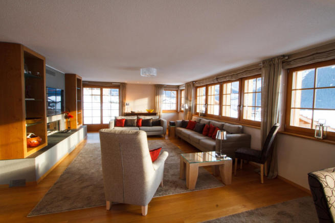 Living room wood floor fireplace Chalet Im Maad Verbier