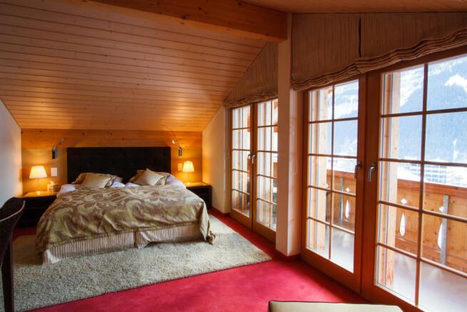 Bedroom twin guest balcony doors Chalet Im Maad Verbier