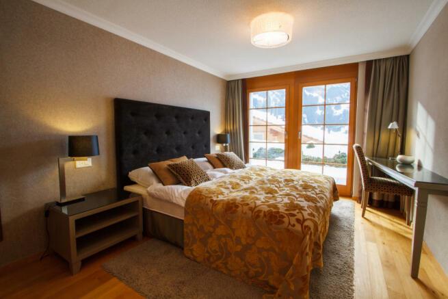Bedroom wood floor balcony doors Chalet Im Maad Verbier