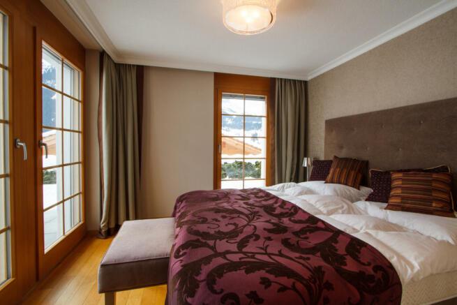 Bedroom master balcony doors Chalet Im Maad Verbier