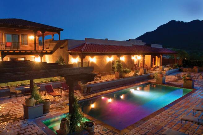 Swimming pool night terrace rear facade South Mill Ranch Arizona