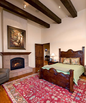 Bedroom fireplace exposed wood beams South Mill Ranch Arizona