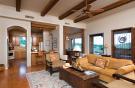 Living room breakfast bar kitchen exposed wood beams floor South Mill Ranch Arizona