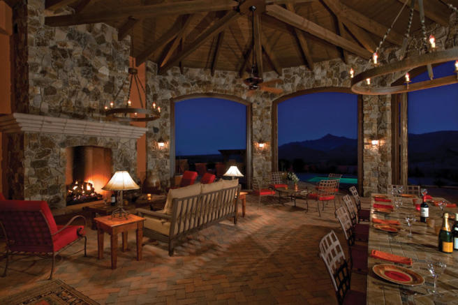 Living room covered terrace fireplace brick floor South Mill Ranch Arizona