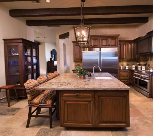 Kitchen breakfast bar stone floor exposed wood beams South Mill Ranch Arizona