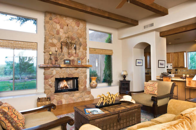 Living room wood floor fireplace exposed beams South Mill Ranch Arizona