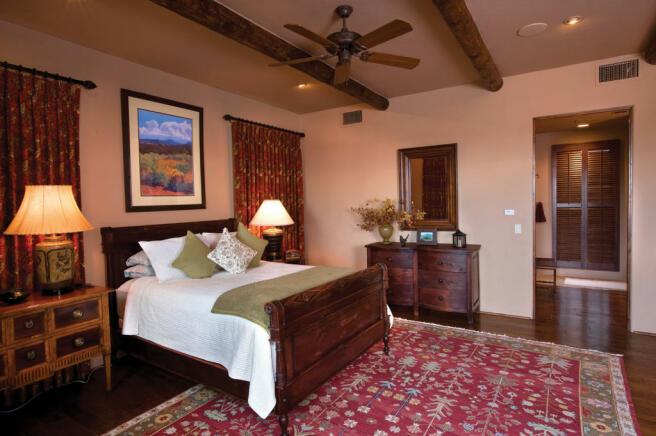 Bedroom wood floor exposed beams South Mill Ranch Arizona