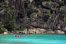 Kayaking below cliffs at Four Seasons Seychelles (Sphere Estates)