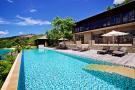 Rear facade swimming pool sun terrace Four Seasons Seychelles