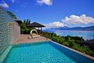 Infinity edge swimming pool ocean sea view Four Seasons Seychelles