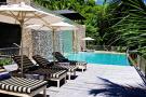 Swimming pool sun terrace Four Seasons Seychelles